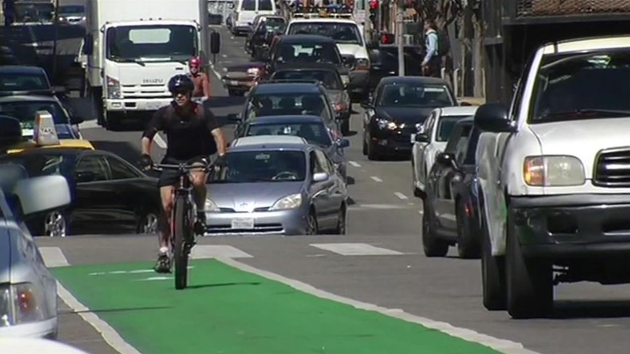 FILE- A cyclist rides throught San Francisco city streets.