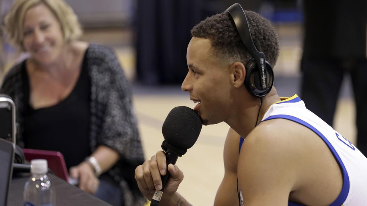 Golden State Warriors Stephen Curry speaks during a radio interview as part of NBA basketball media day Monday, Sept. 28, 2015, in Oakland, Calif.