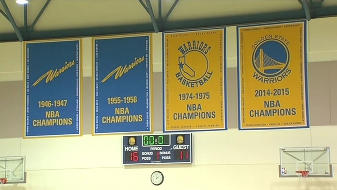NBA championship banners are shown during a Golden State Warriors practice on Tuesday, September 29, 2015 in Oakland, Calif.