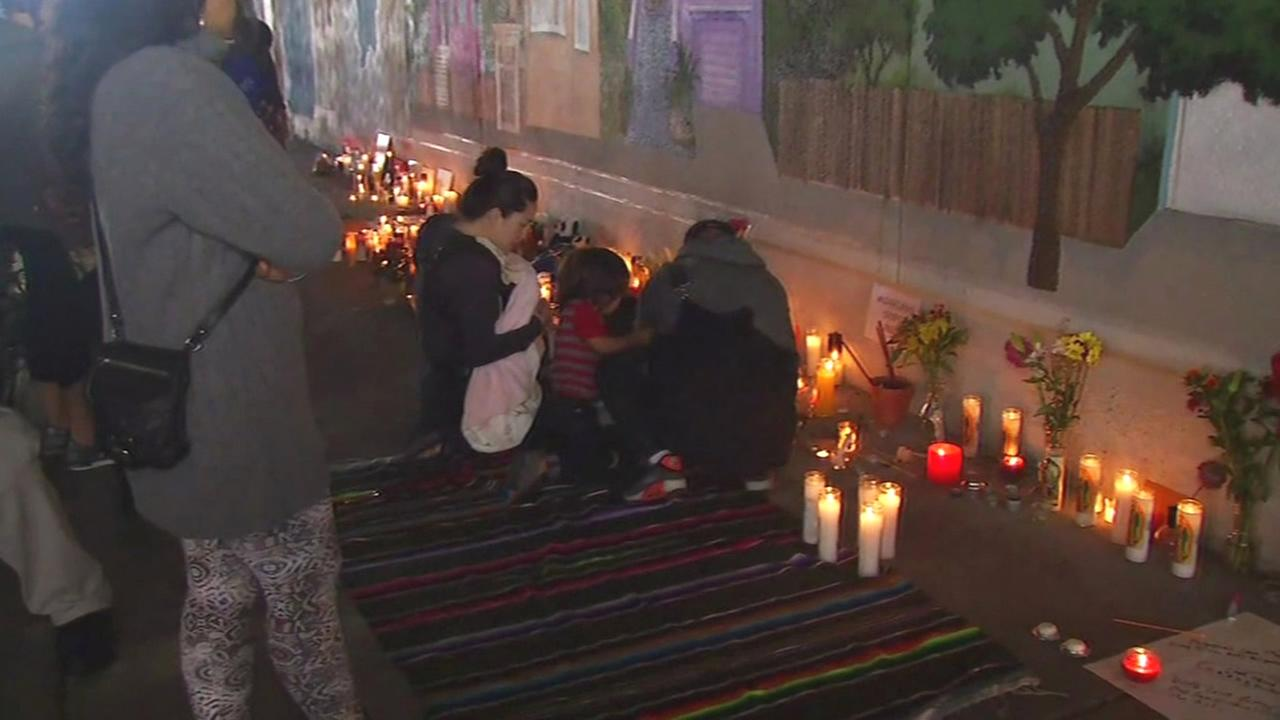A vigil was held on Wednesday, September 30, 2015 for 27-year-old Antonio Ramos, who was shot and killed the day before while working on a mural in West Oakland, Calif.