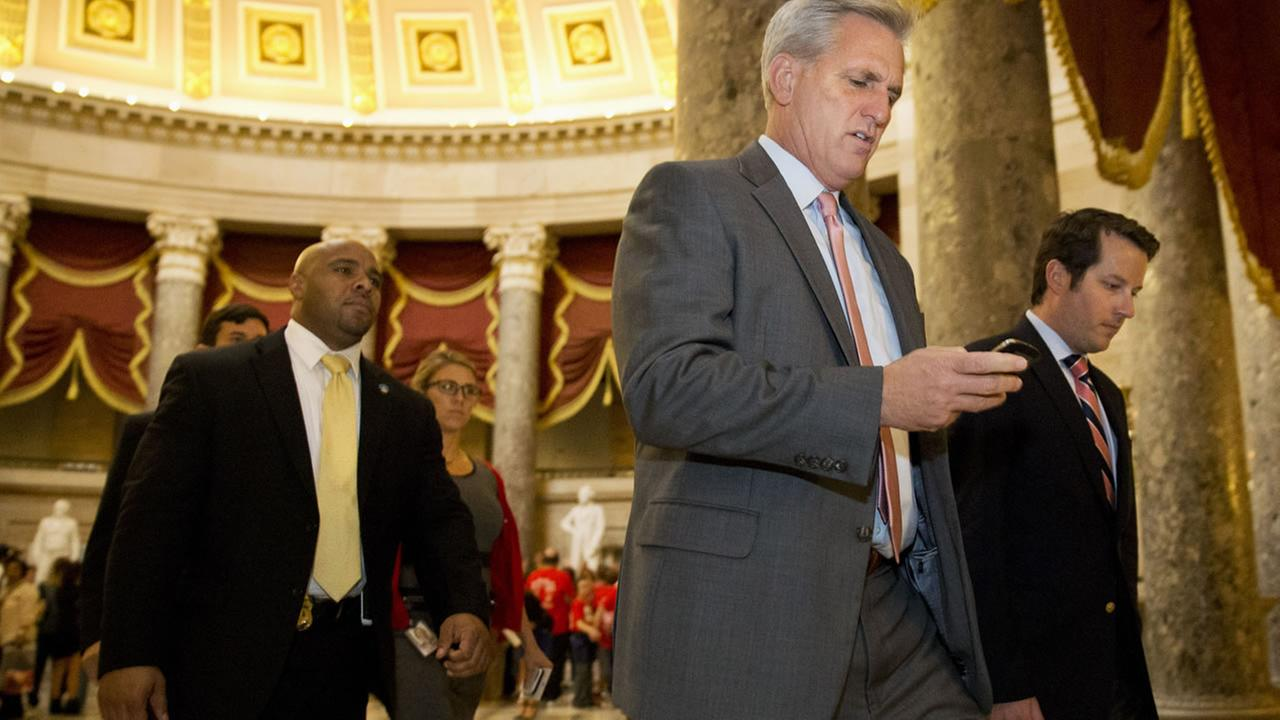 House Majority Leader Kevin McCarthy of Calif. walks to a procedural vote in the House on a stopgap spending bill to avert a government shutdown on Sep. 30, 2015. (AP Photo)