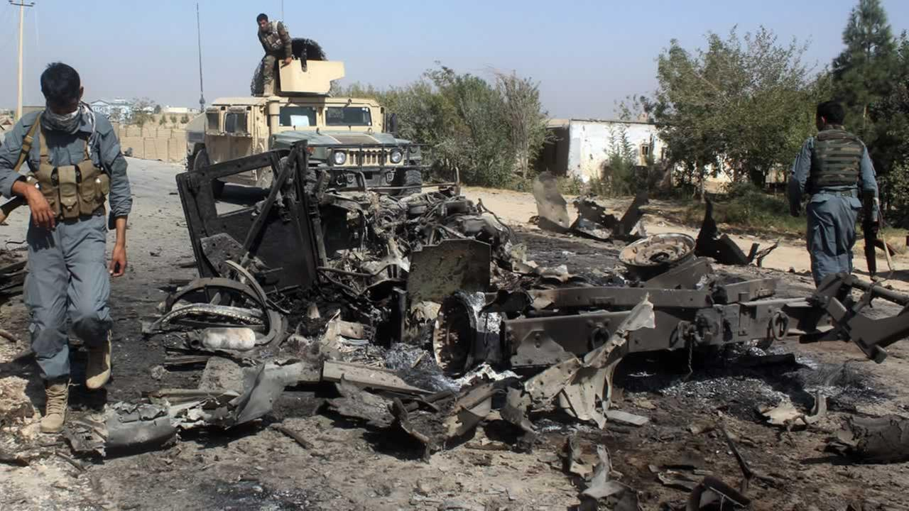 Afghan security forces inspect the site of a U.S. airstrike in Kunduz city, north of Kabul, Afghanistan, Friday, Oct. 2, 2015.