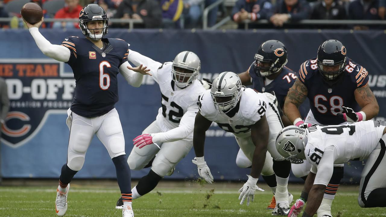 Chicago Bears quarterback Jay Cutler (6) throws a pass under pressure by Oakland Raiders during the first half of an NFL football game, Sunday, Oct. 4, 2015, in Chicago. (AP Photo)