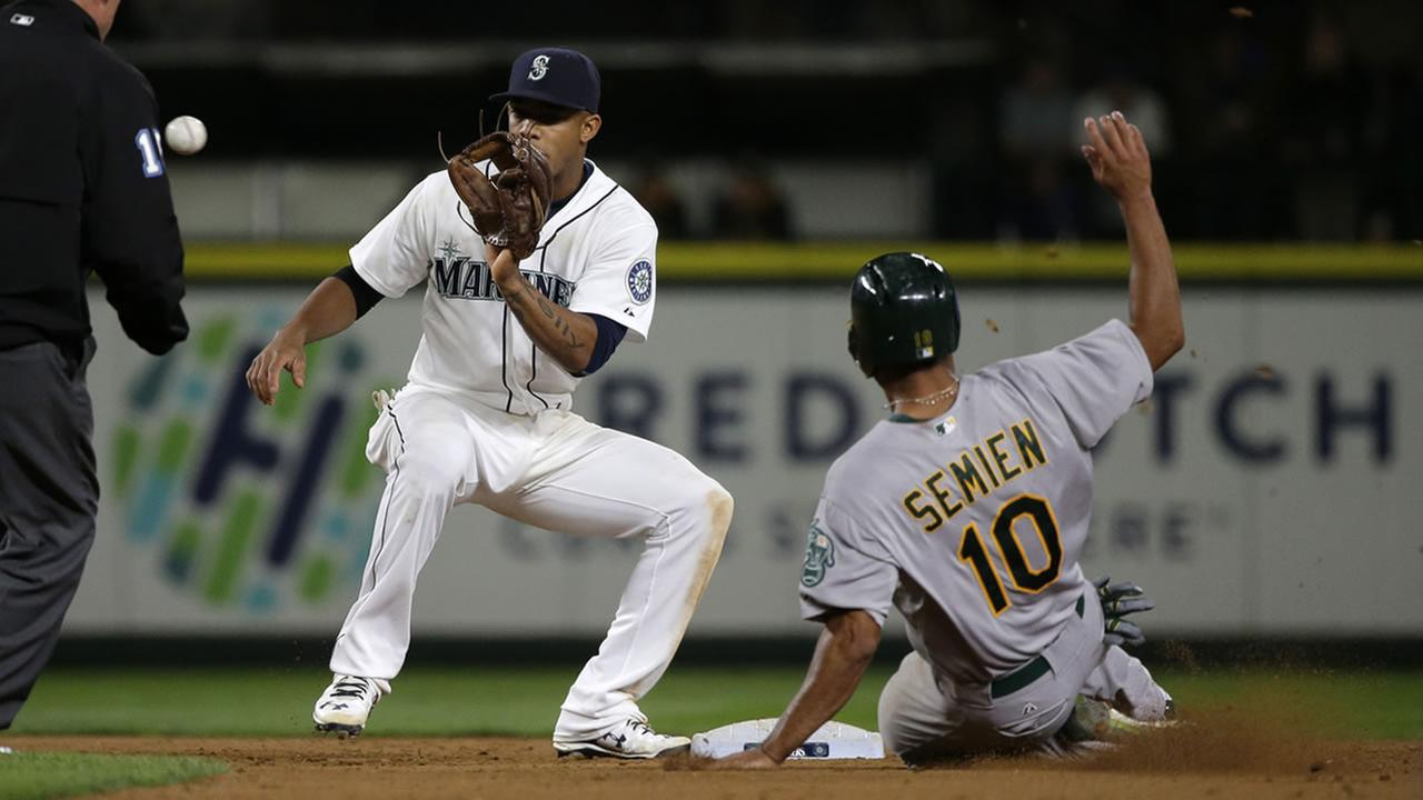 Mariners Ketel Marte makes the catch to get Athletics Marcus Semien out at as he tries to steal second base during a game, Saturday, Oct. 3, 2015, in Seattle. (AP Photo)