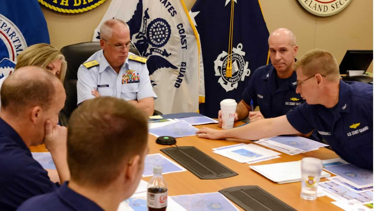 Rear Adm. Scott Buschman receives an update brief for the missing cargo ship El Faro at the Coast Guard 7th District in Miami, Saturday, Oct. 3, 2015.
