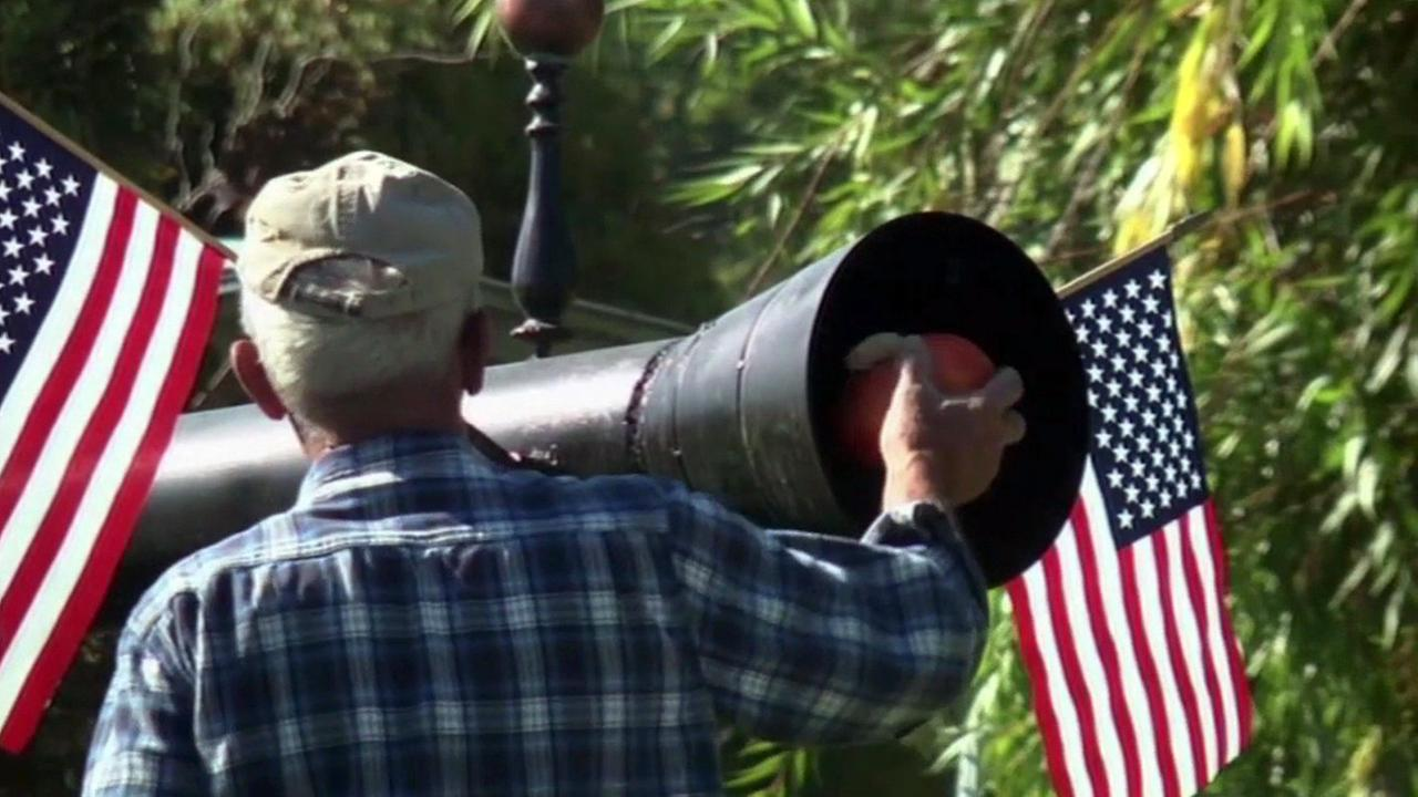 Farmer uses cannon to shoot pumpkins on Washington farm.