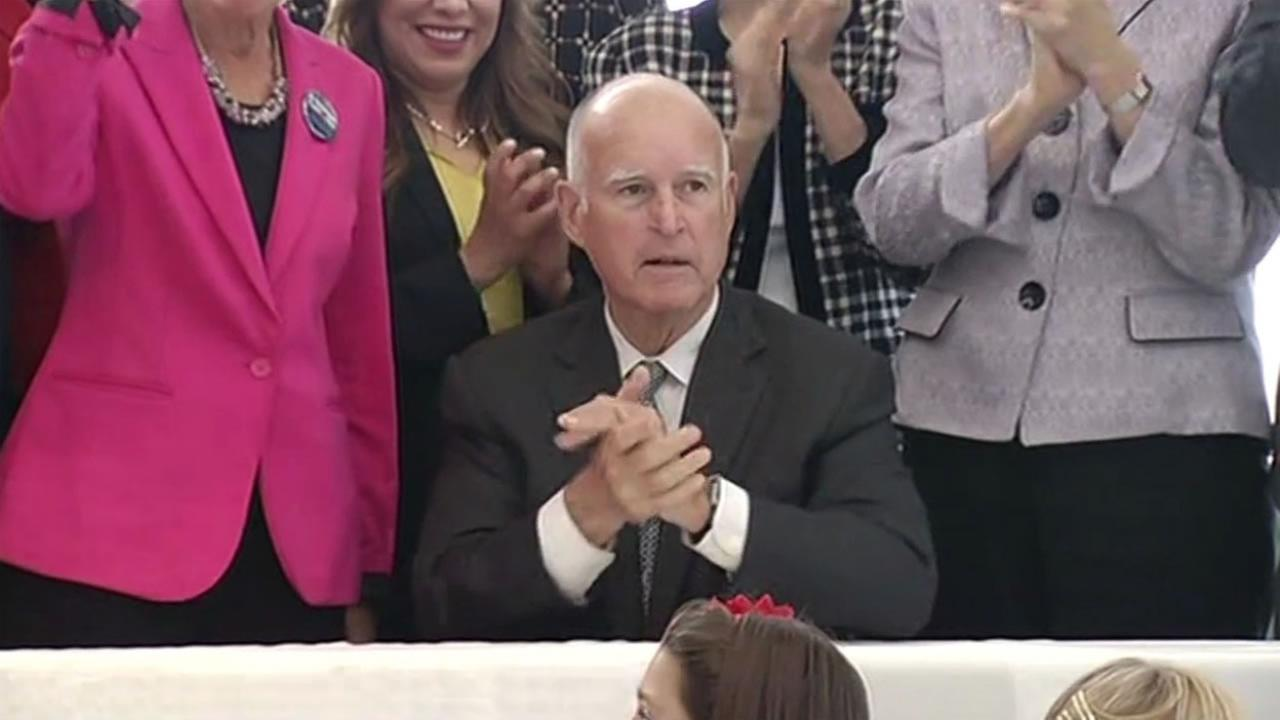 Governor Jerry Brown signs the Fair Pay Act at the Rosie the Riveter Museum in Richmond, Calif. Oct. 6, 2015.
