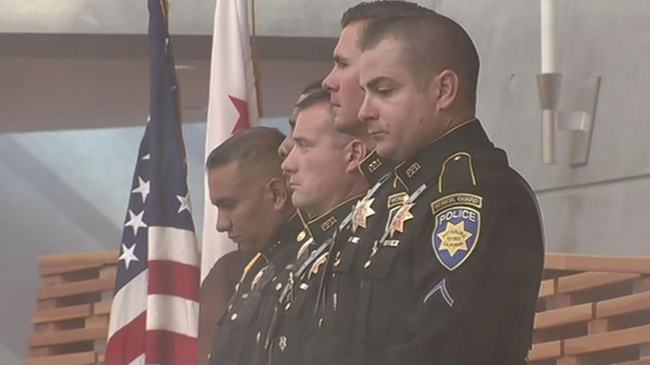 Bay Area law enforcement attended a blue mass at an Oakland church where they honored first responders and those killed in the line of duty, Oct. 9, 2015.