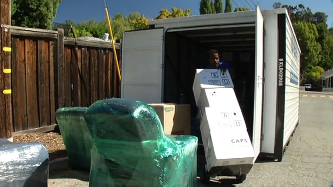 A woman hired moving professionals to load belongings into a rented shipping container in San Anselmo, Calif. on Friday, October 9, 2015.