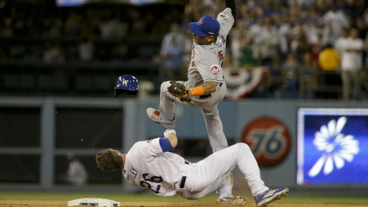 New York Mets Ruben Tejada, goes over the top of Los Angeles Dodgers Chase Utley during Game 2 of baseballs National Legue Division Series, Saturday, Oct. 10, 2015 in LA.
