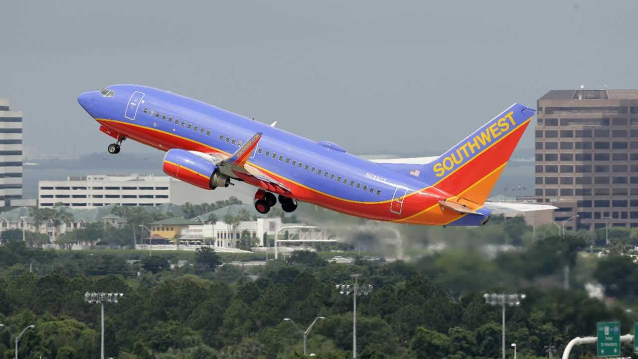 In this Thursday, May 15, 2014 photo, a Southwest Airlines Boeing 737-700 takes off from the Tampa International Airport in Tampa, Fla.
