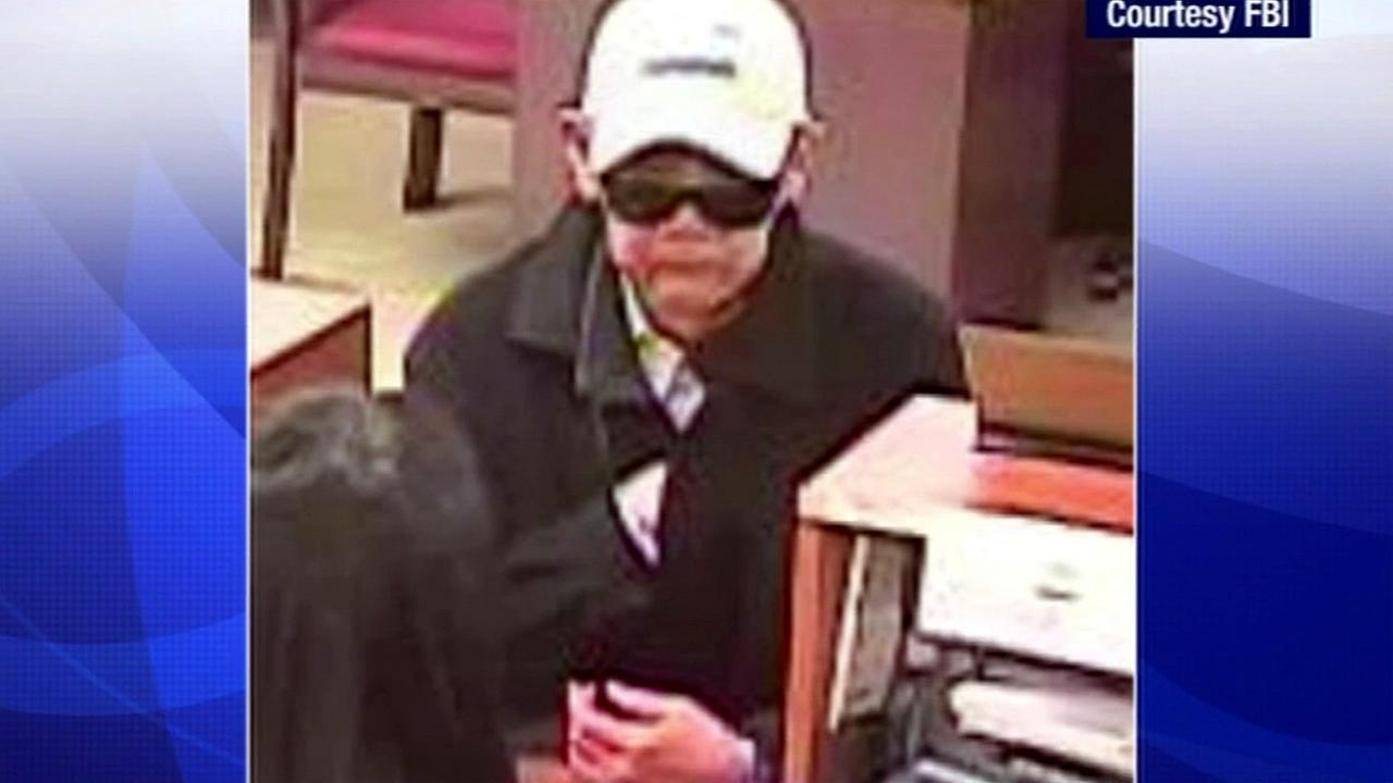 The FBI is offering a reward of up to $5,000 for information leading to the arrest of a suspect named Droopy Face Bandit who is accused of robbing at least 10 banks in San Francisco.