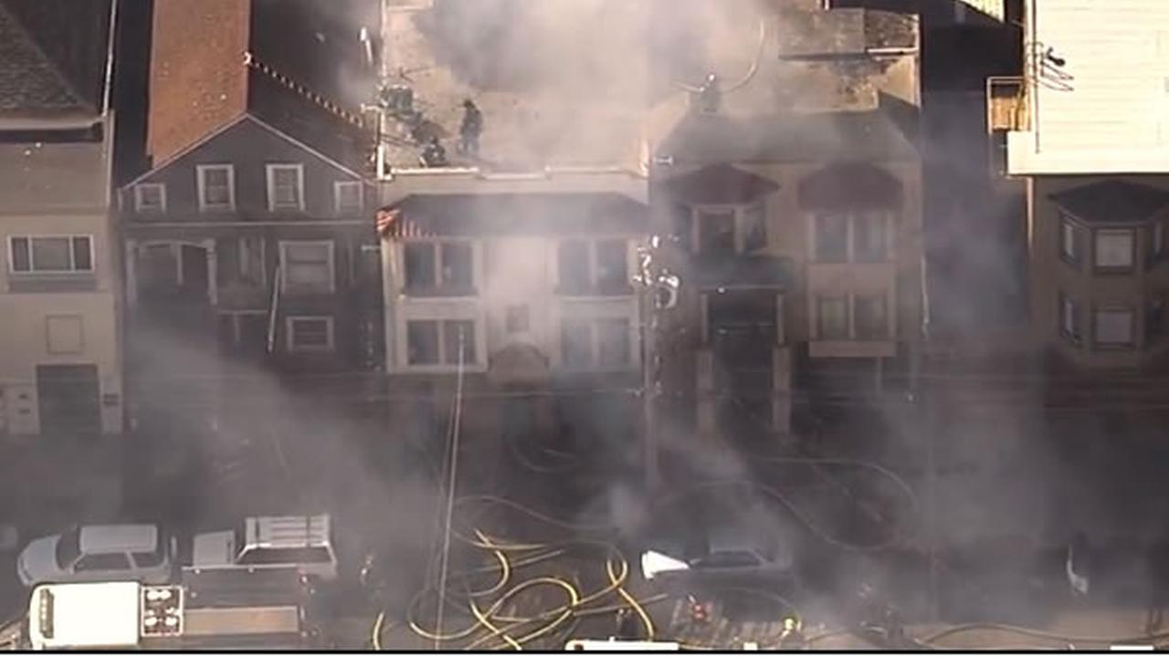 Crews battled a three-alarm fire burning a three-story house in San Franciscos Inner Richmond District on Friday, October 16, 2015.