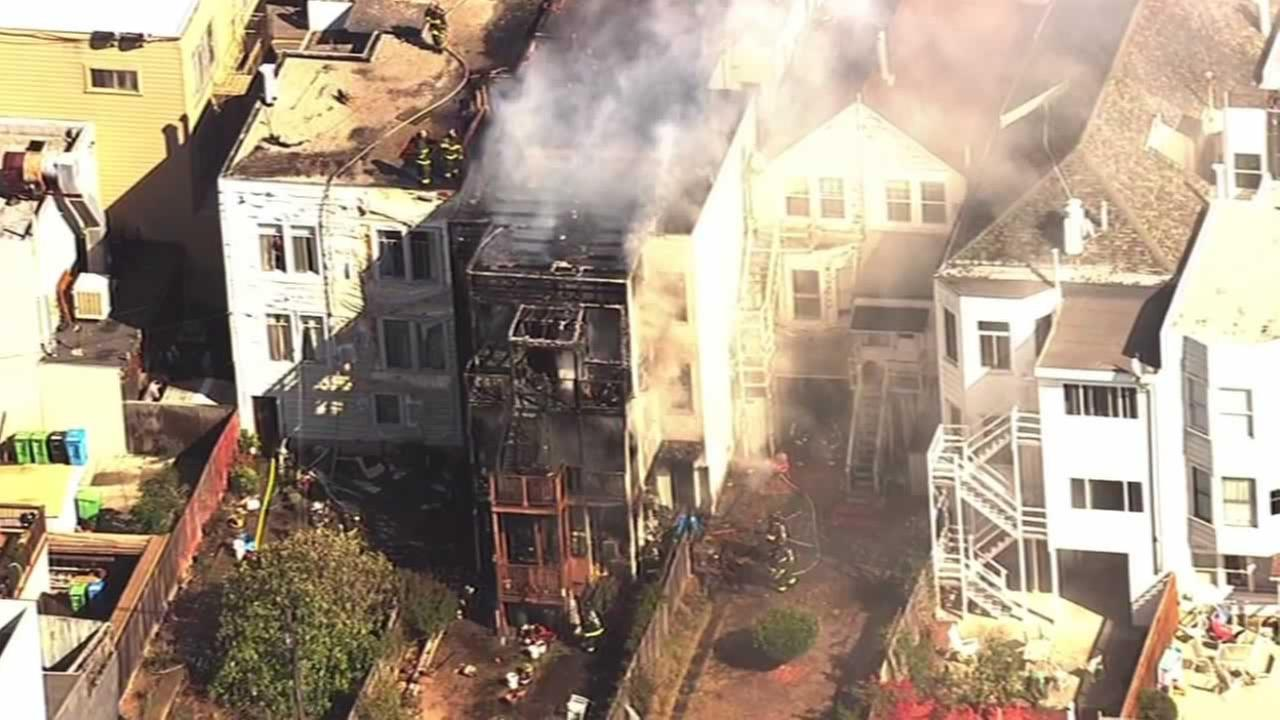 Firefighters battled a three-alarm blaze at a three-story home in San Franciscos Inner Richmond District on Friday, October 16, 2015.
