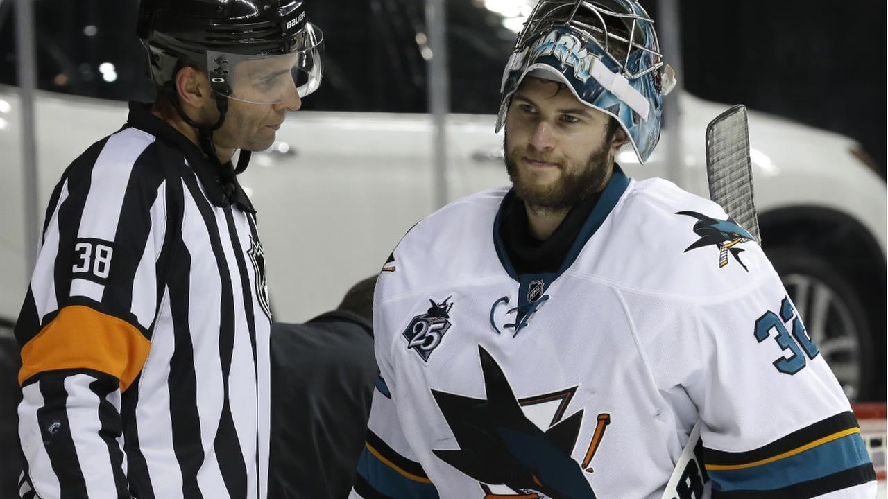 San Jose Sharks goalie Alex Stalock listens as referee Francois St Laurent explains a call against the New York Islanders, Saturday, Oct. 17, 2015 in New York.