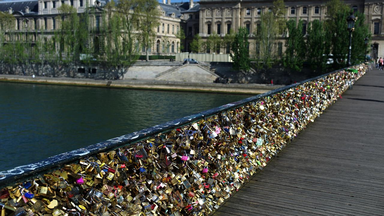 FILE -- This April 9, 2014 photo shows love locks fixed on the Pont des Arts in Paris.