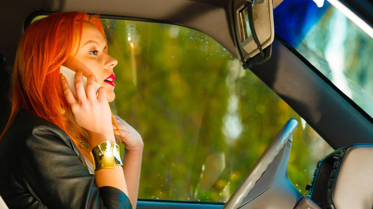 Teen on a cellphone distracted driving.