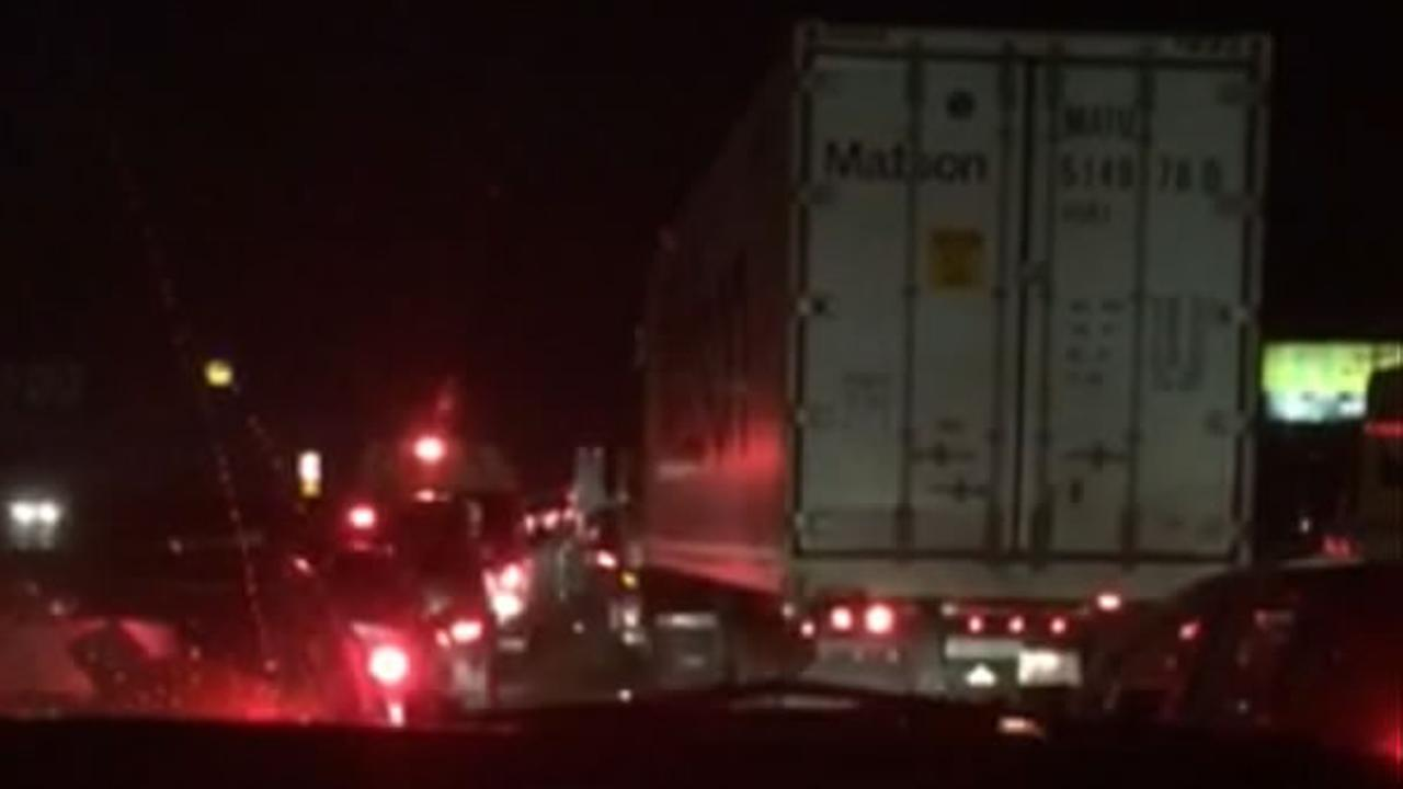 The traffic is backed up on I-880 after falling debris caused a crash, closing all lanes of the freeway on Monday, October 19, 2015 in Oakland, Calif.