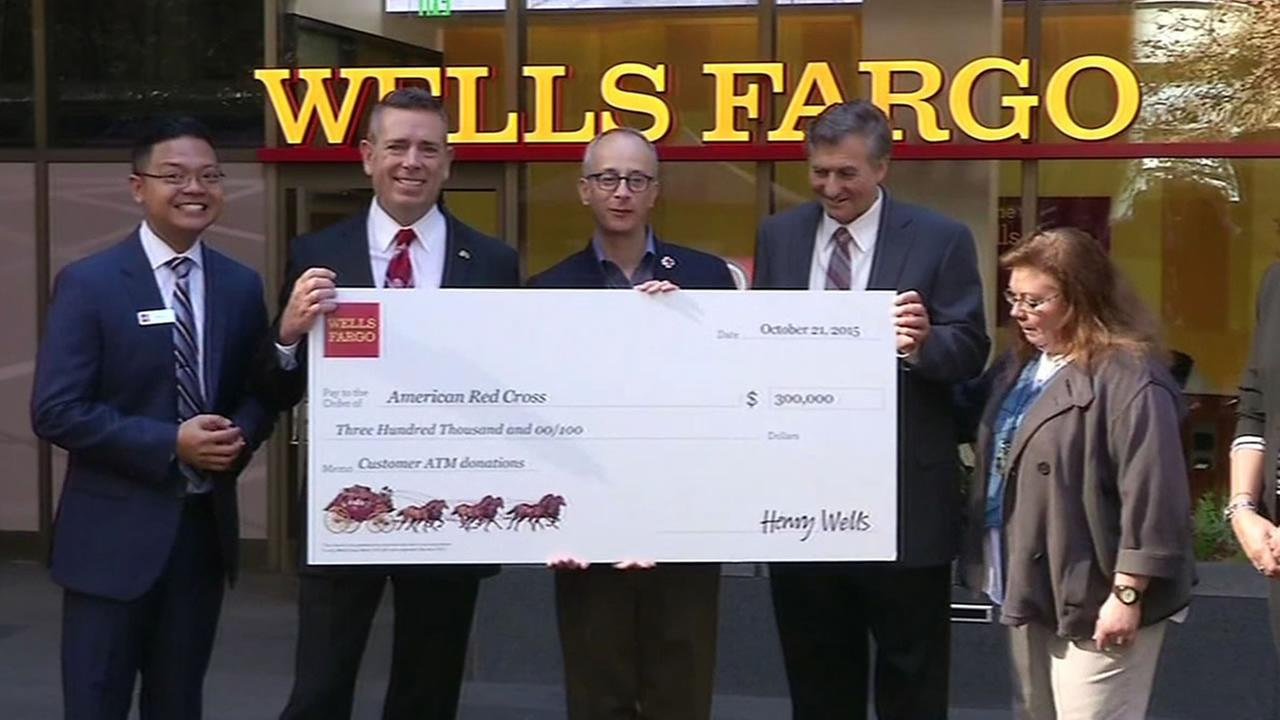 Wells Fargo executives give check to Red Cross