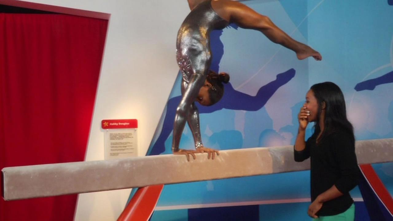 Olympic gymnast Gabby Douglas reacts to the unveiling of her wax figure at Madame Tussauds at Fishermans Wharf in San Francisco.