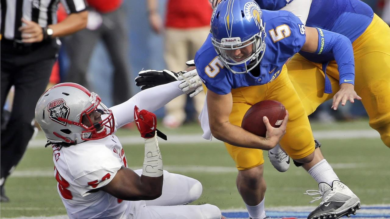 New Mexico linebacker Maurice Daniels, left, sacks San Jose State quarterback Kenny Potter during the first half of an NCAA college football game Saturday, Oct. 24, 2015, in San Jose, Calif.