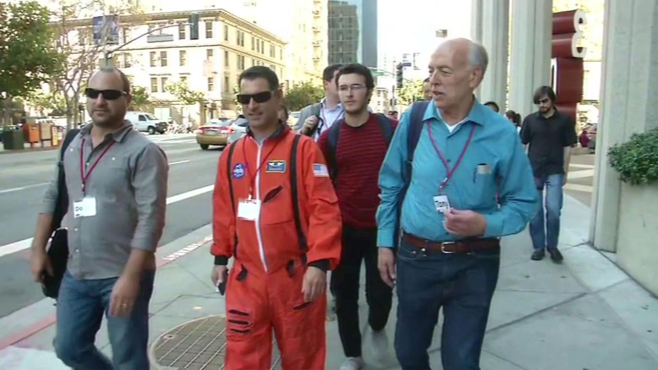 Founder of the Tech Crawl, Myles Weissleder, center, and others walk in the third annual Tech Crawl Oct. 30, 2015 in San Francisco, Calif.