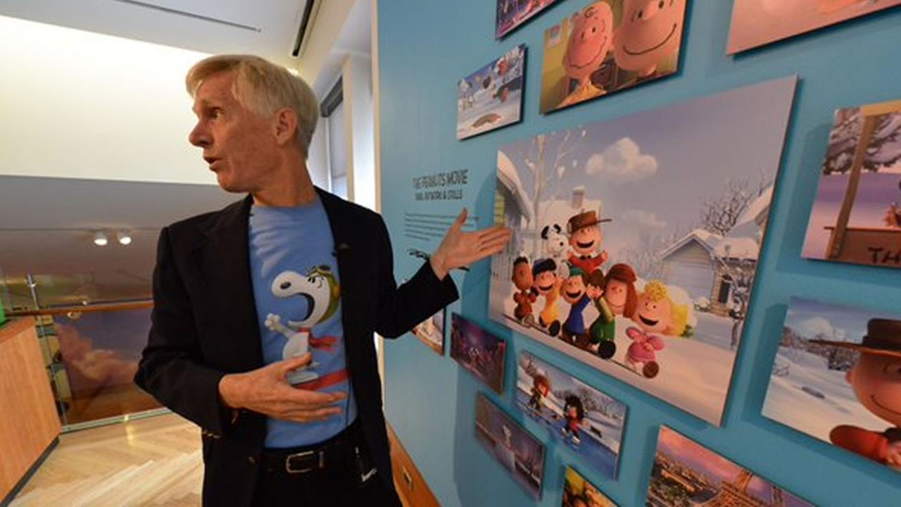 Charles Schulz son Craig Shultz points to stills from the new Peanuts movie while at the Charles Shulz Museum in Santa Rosa, Calif. Oct. 30, 2015.