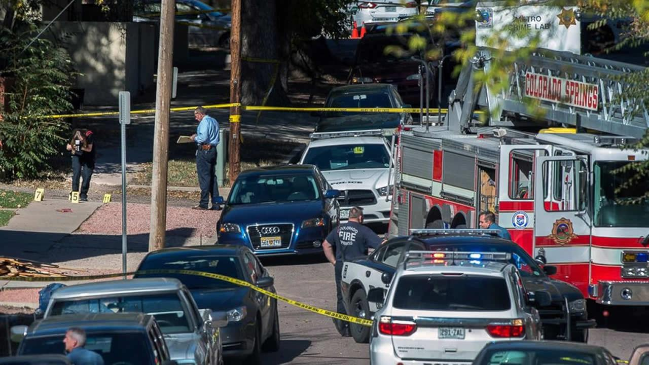 Police investigate the scene after a shooting Saturday, Oct. 31, 2015, in Colorado Springs, Colo.