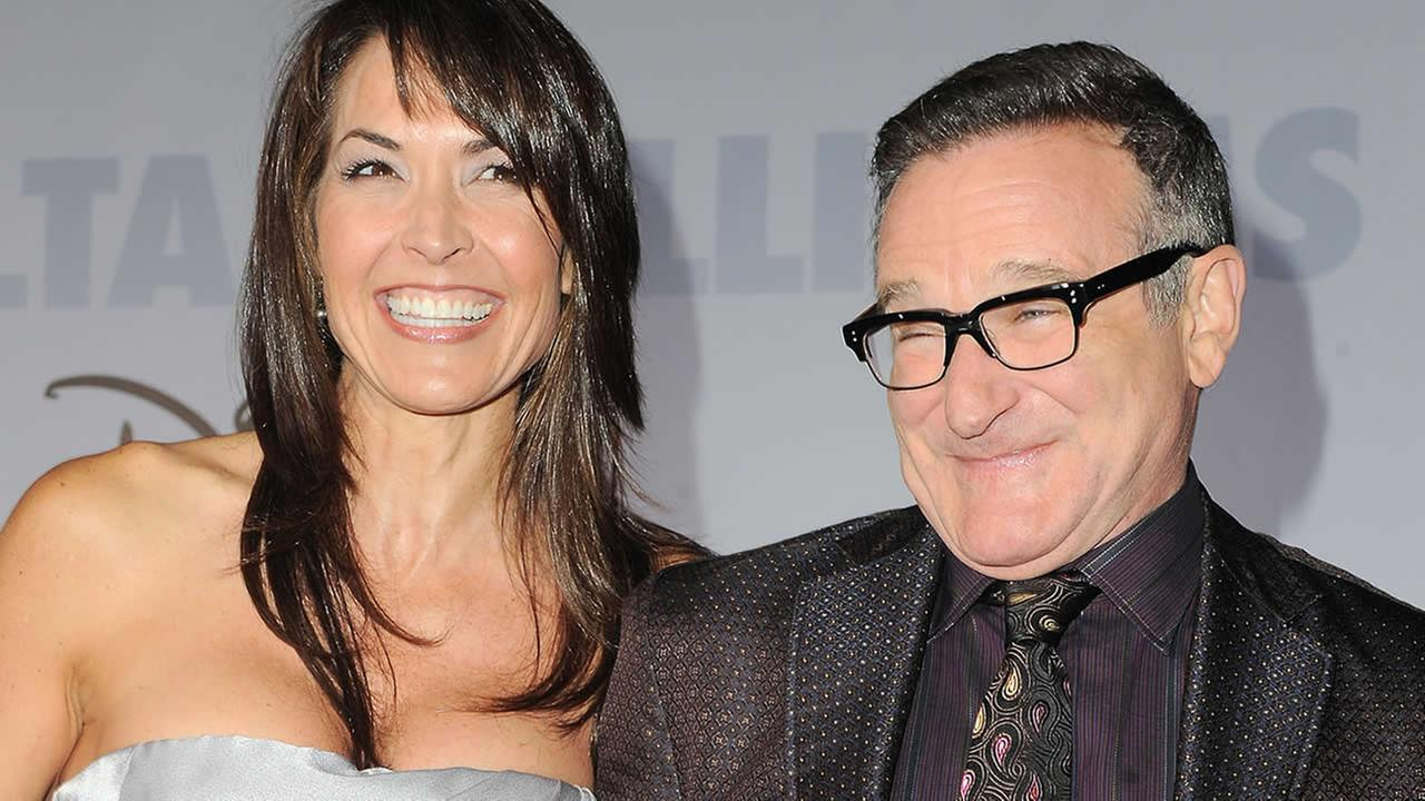 This Nov. 9, 2009 file photo shows actor Robin Williams, right, and his wife Susan Schneider at the premiere of Old Dogs in Los Angeles. (AP Photo/Katy Winn, FIle)