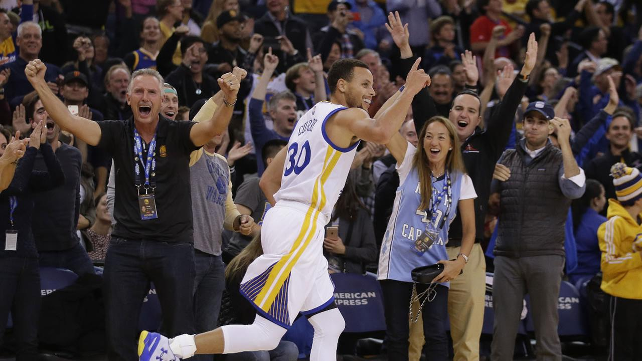 Golden State Warriors Stephen Curry (30) celebrates after a three-point basket against the Memphis Grizzlies during the second half of an NBA basketball game Monday, Nov. 2, 2015.