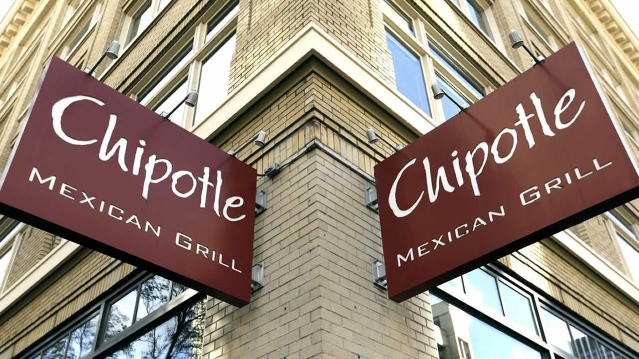 Signage hangs from a closed Chipotle restaurant in Portland, Ore., Monday, Nov. 2, 2015.