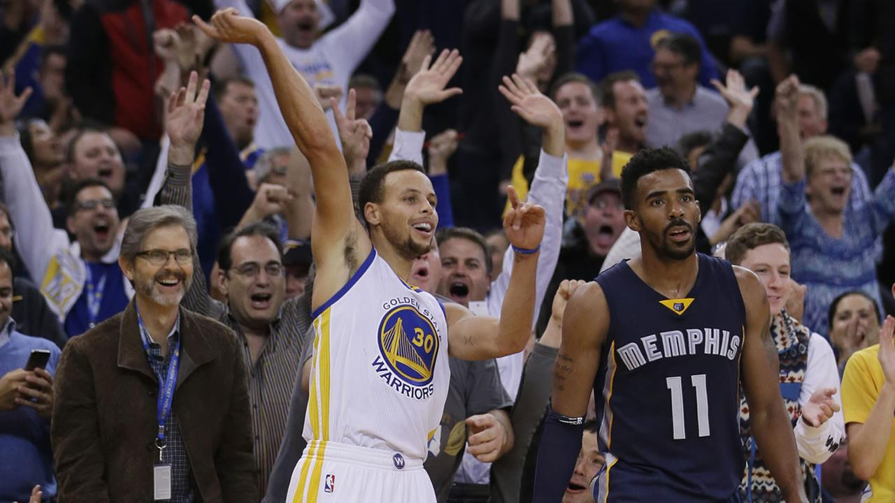 Warriors Stephen Curry (30) celebrates after making a three-point basket next to Grizzlies Mike Conley (11) during the second half of a game Nov. 2, 2015, in Oakland, Calif. (AP Photo/Marcio Jose Sanchez)