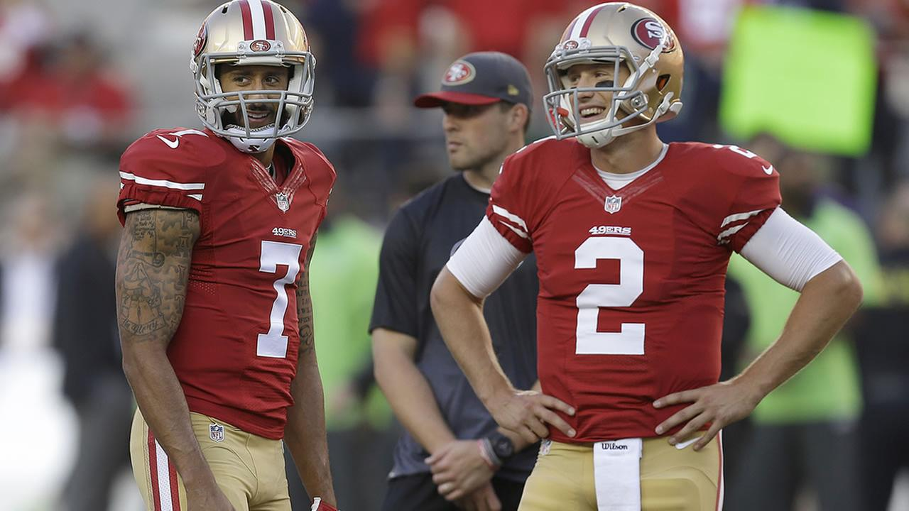 Colin Kaepernick stands next to Blaine Gabbert