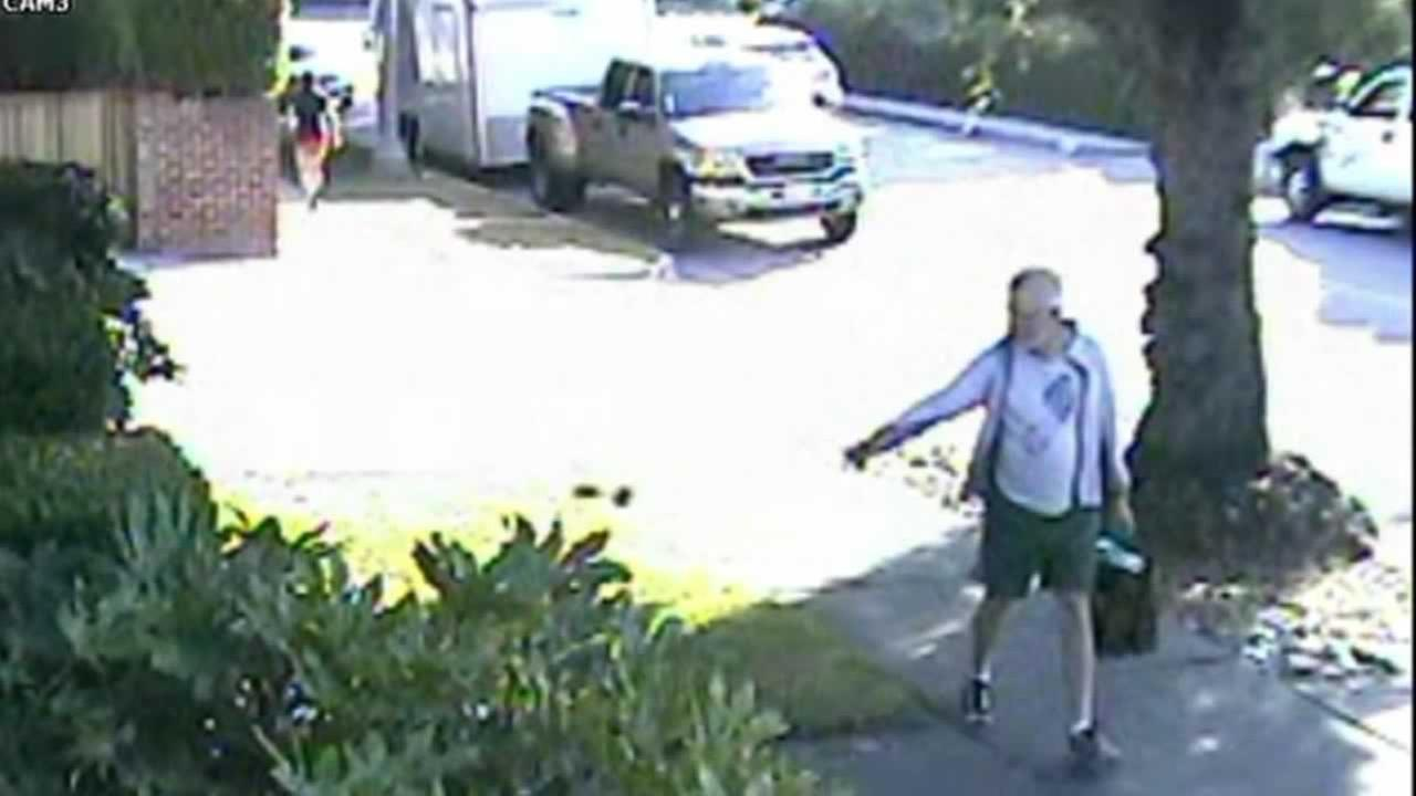 Surveillance video in San Marino shows Mayor Dennis Kneier strolling down the street and casually tossing the feces onto his neighbors walkway.