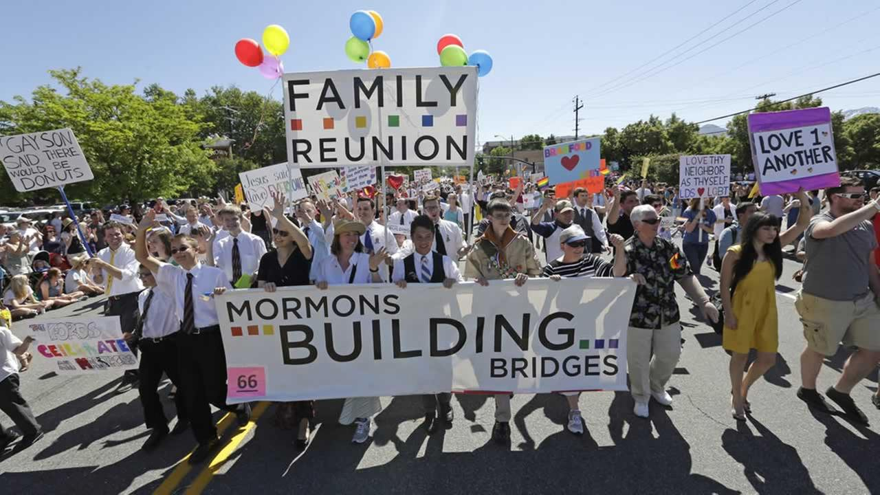 In this June 2, 2013, file photo, members of the Mormons Building Bridges march during the Utah Gay Pride Parade in Salt Lake City.