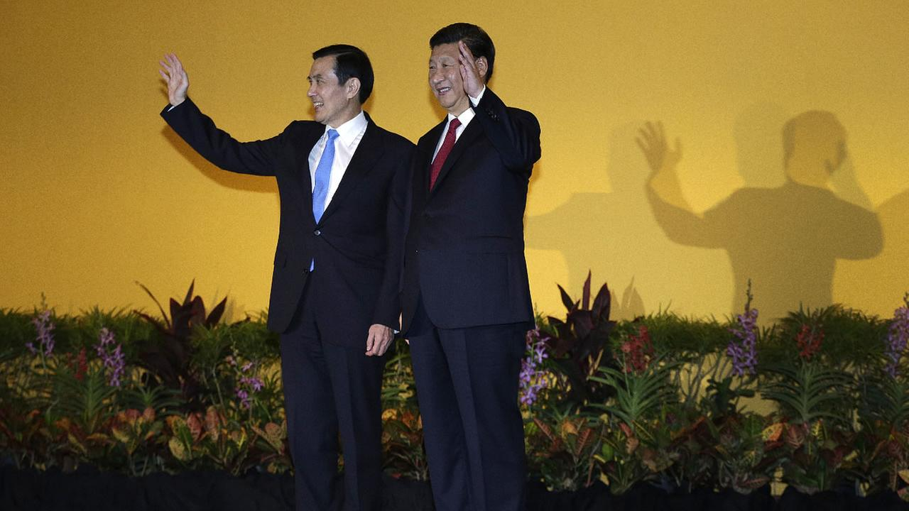 Chinese President Xi Jinping, right, and Taiwanese President Ma Ying-jeou, left, shake hands at the Shangri-la Hotel on Saturday, Nov. 7, 2015, in Singapore.