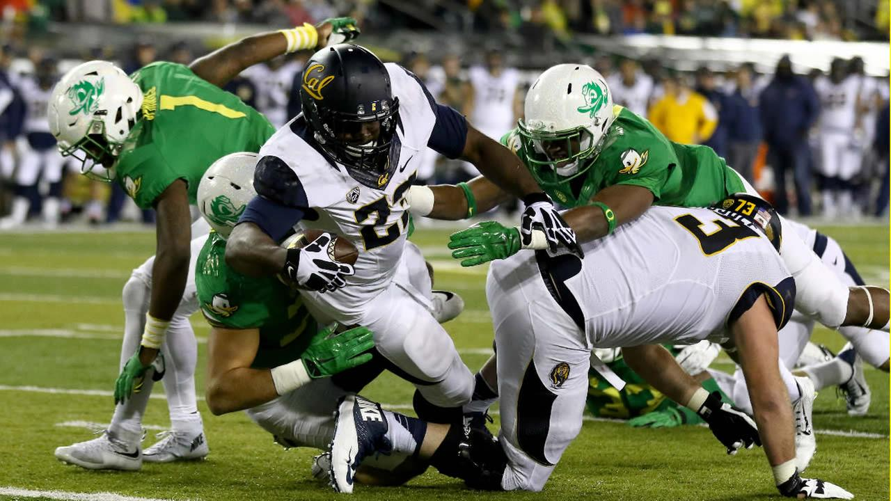 California running back Vic Enwere (23) scores a touchdown during the second half of an NCAA college football game against Oregon, Saturday, Nov. 7, 2015, in Eugene, Ore.