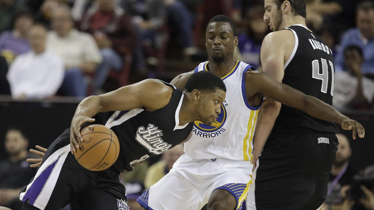Sacramento Kings forward Rudy Gay, left, drives against Golden State Warriors forward Harrison Barnes, center, in Sacramento, Calif., Saturday, Nov. 7, 2015.