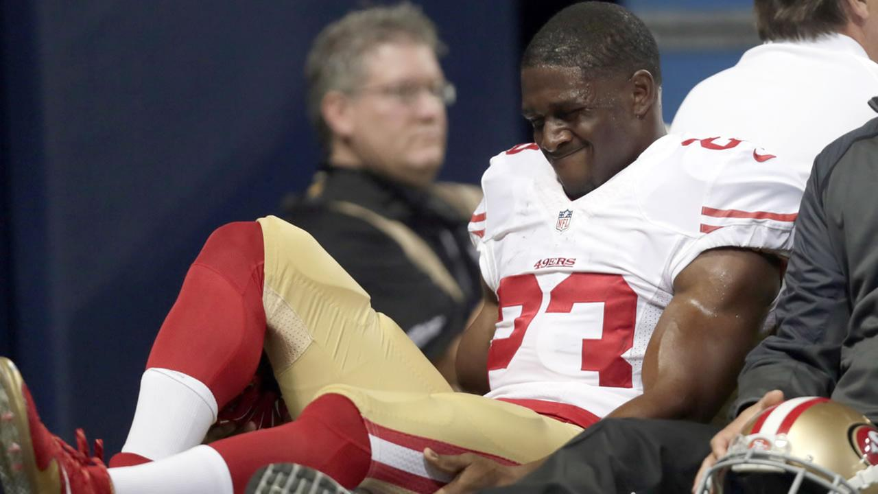 49ers running back Reggie Bush is taken off on a cart during the first quarter of an NFL football game against the St. Louis Rams Sunday, Nov. 1, 2015, in St. Louis.