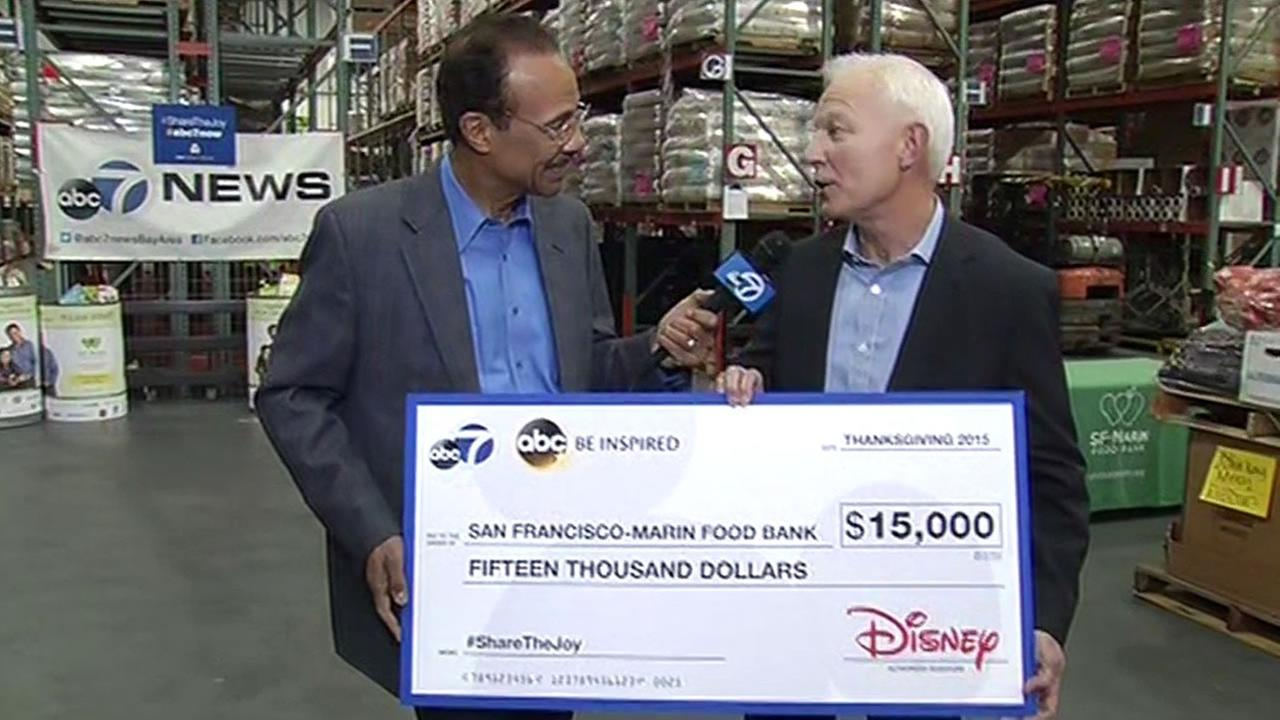 On behalf of ABC7 and Disney, Spencer Christian presented a check to SF-Marin Food Bank executive director Paul Ash on Monday, November 9, 2015.KGO-TV