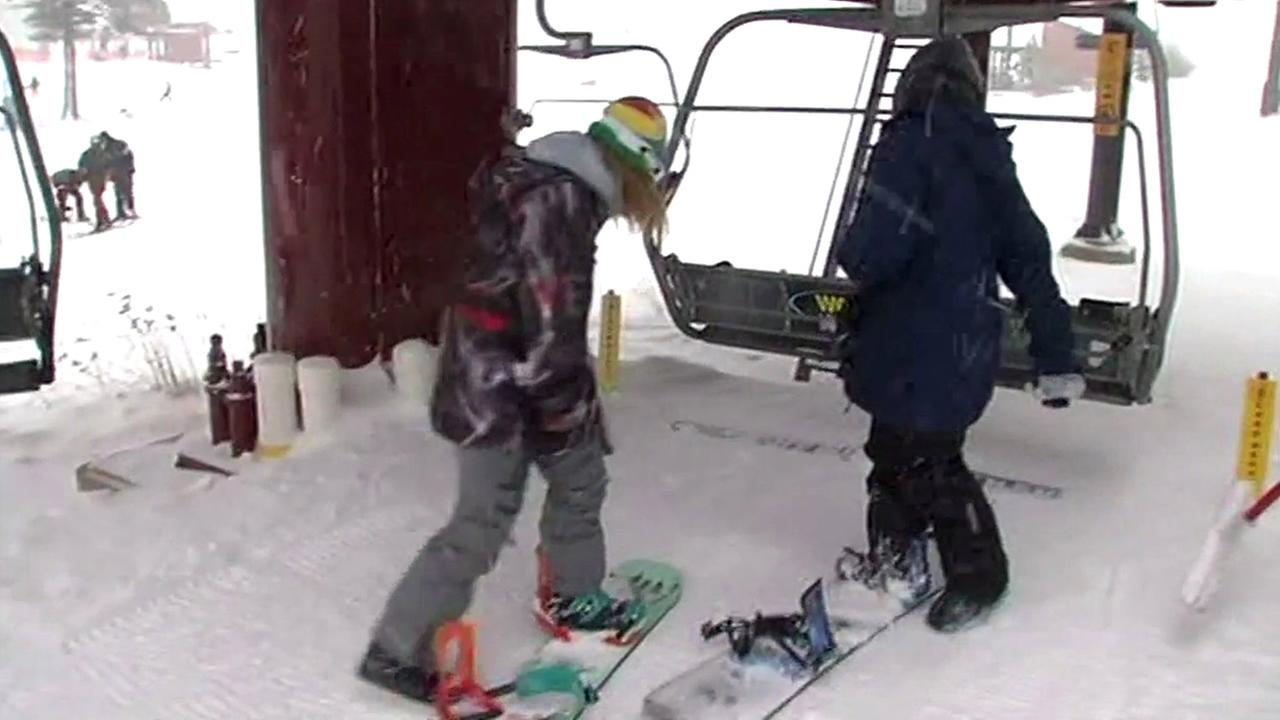 Snowboarders get ready to get on a lift at Boreal Mountain Resort in Soda Springs, Calif. on Monday, November 9, 2015.