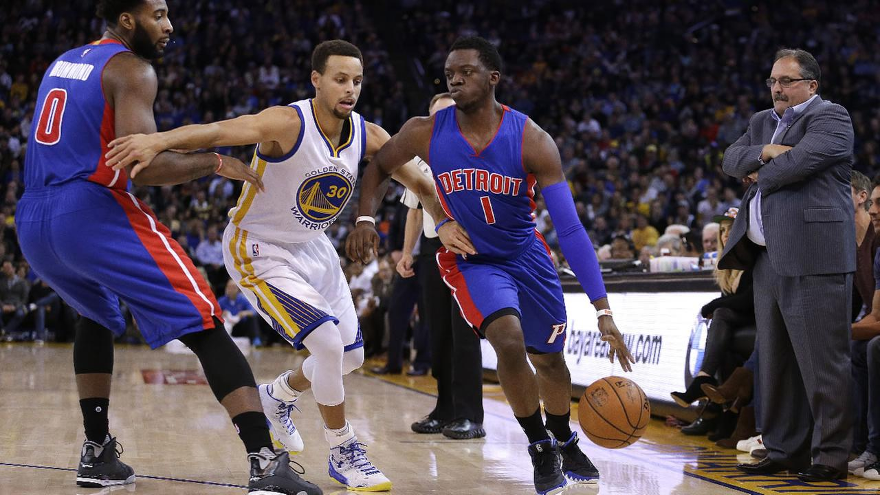 Detroit Pistons Andre Drummond, left, screens Golden State Warriors Stephen Curry, center, as Reggie Jackson, right, drives the ball during the first half of game Monday, Nov. 9.