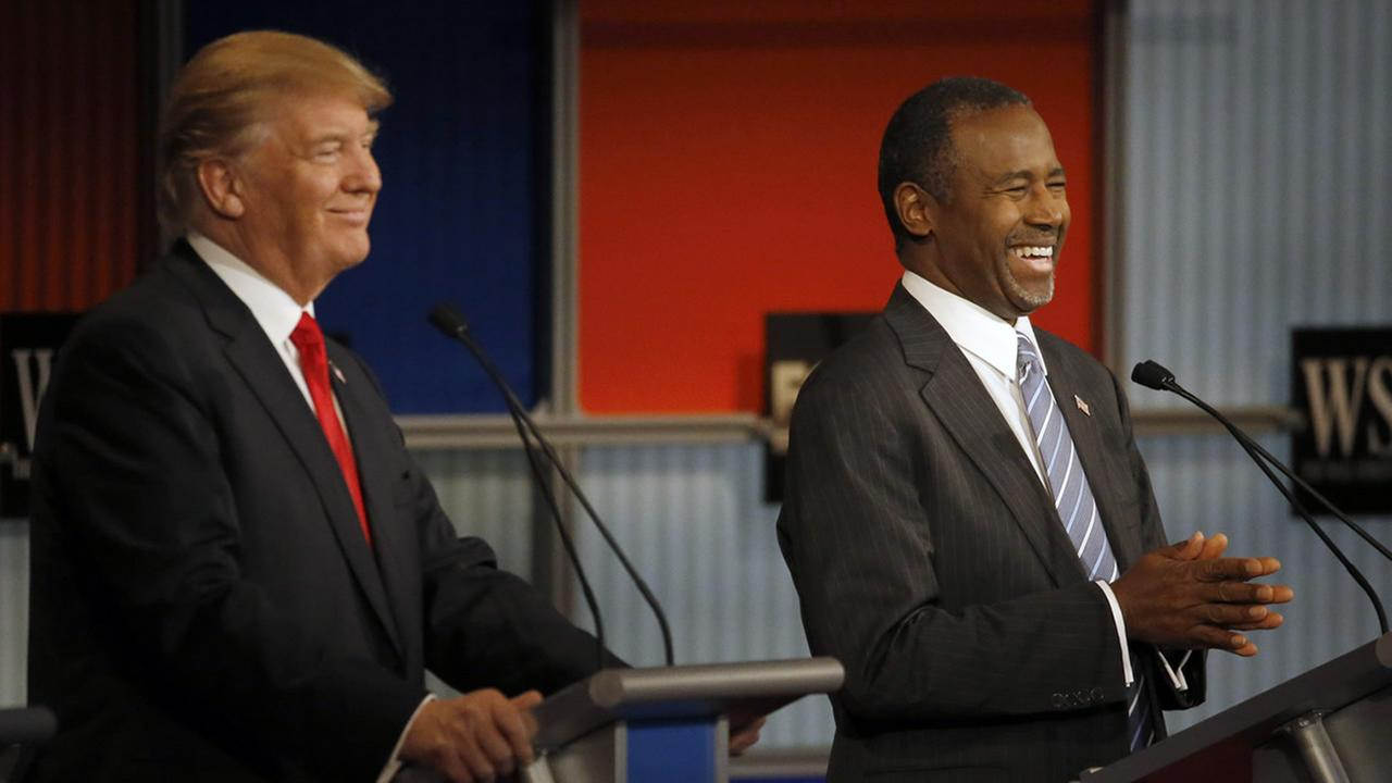 Donald Trump and Ben Carson laugh during Republican presidential debate at Milwaukee Theatre, Tuesday, Nov. 10, 2015, in Milwaukee. (AP Photo/Morry Gash)