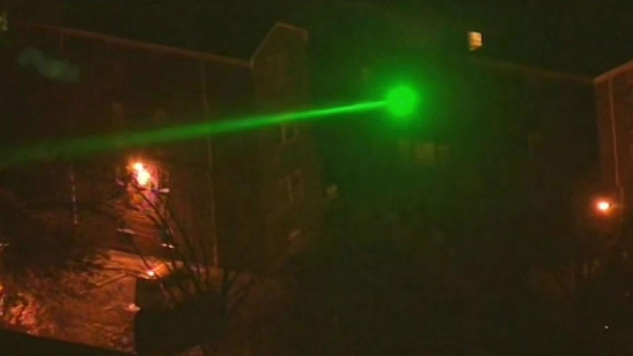 green laser being pointed at an aircraft