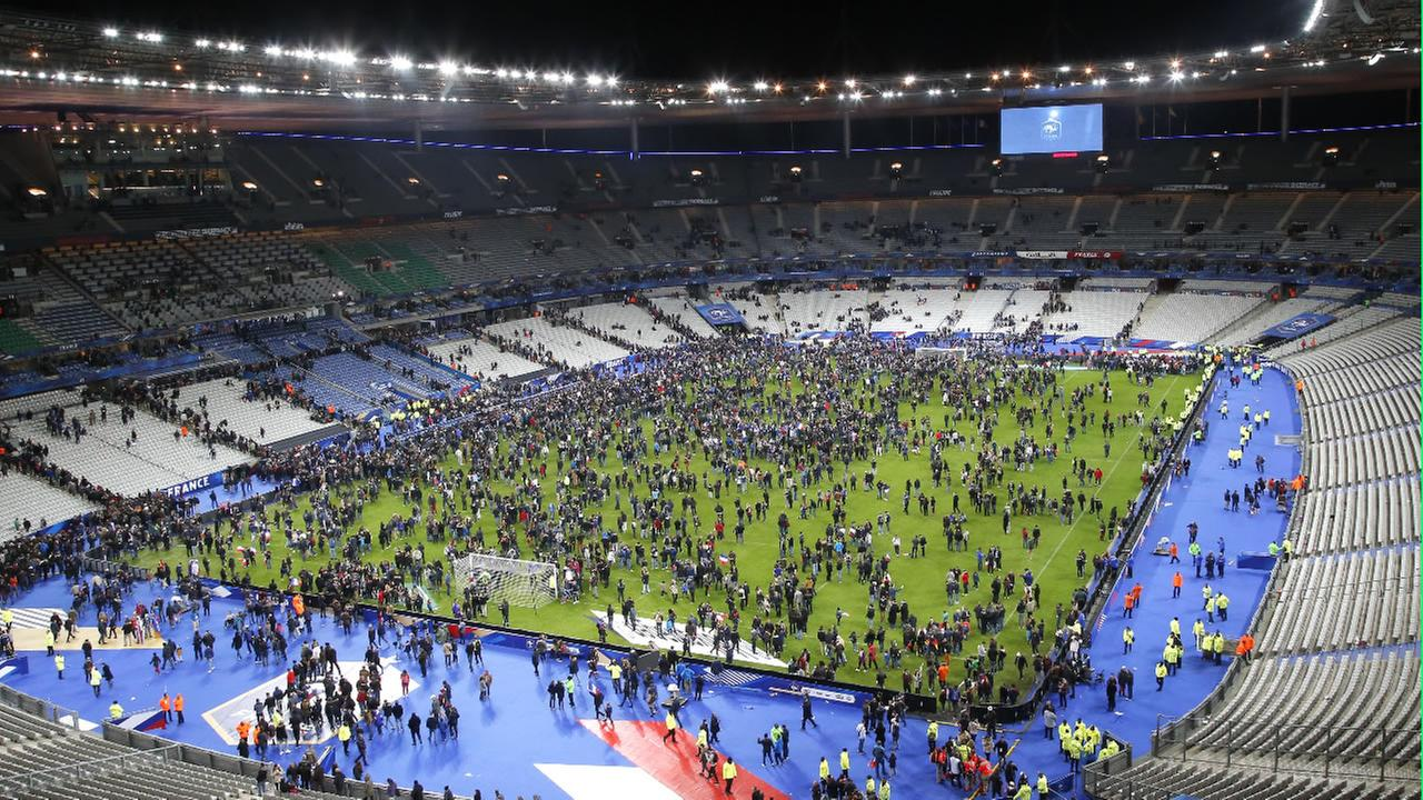 Spectators invade the pitch of the Stade de France stadium after the international friendly soccer France against Germany, Friday, Nov. 13, 2015 in Saint Denis, outside Paris.