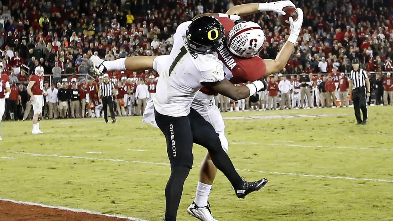 Stanford tight end Greg Taboada catches a touchdown pass in front of Oregon defensive back Arrion Springs in a on Saturday, Nov. 14, 2015, in Stanford, Calif.