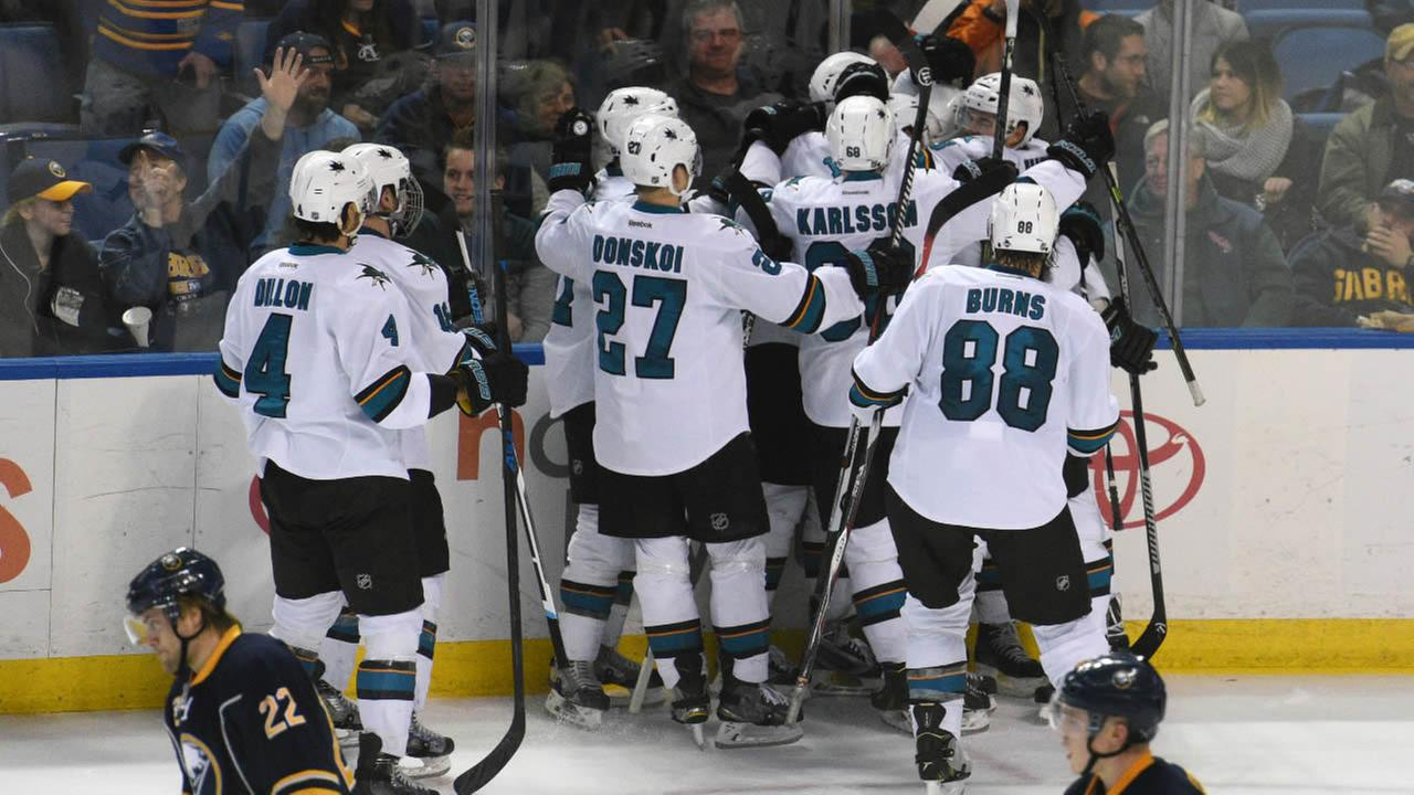 San Jose Sharks left winger Patrick Marleau gets a team celebration after he scored the game-winning goal as Buffalo Sabres in a on Saturday Nov. 14, 2015 in Buffalo, N.Y.