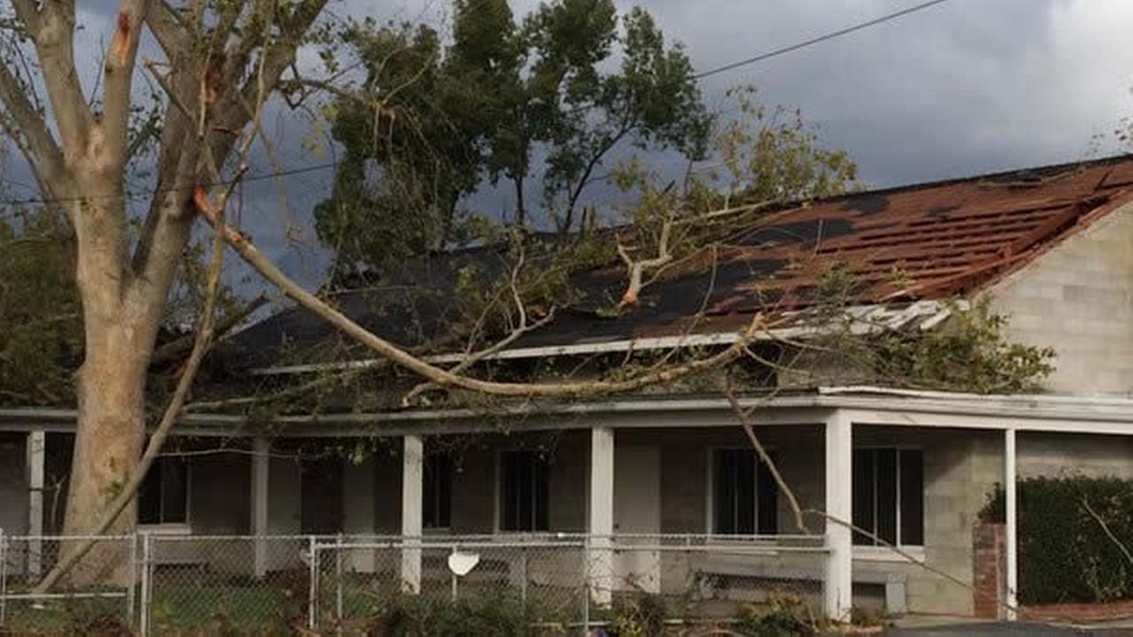 In this image, a church is damaged by a tree after it fell on top of its roof during a tornado that hit Denair in Stanislaus County, Calif. on Sunday November 11, 2015.