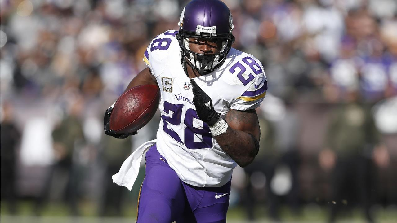 Vikings Adrian Peterson runs against the Raiders during the first half of an NFL football game in Oakland, Calif., Sunday, Nov. 15, 2015. (AP Photo/Beck Diefenbach)