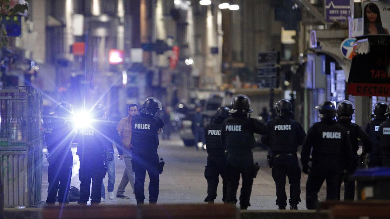 Police forces prepare in St. Denis, a northern suburb of Paris, Wednesday, Nov. 18, 2015.